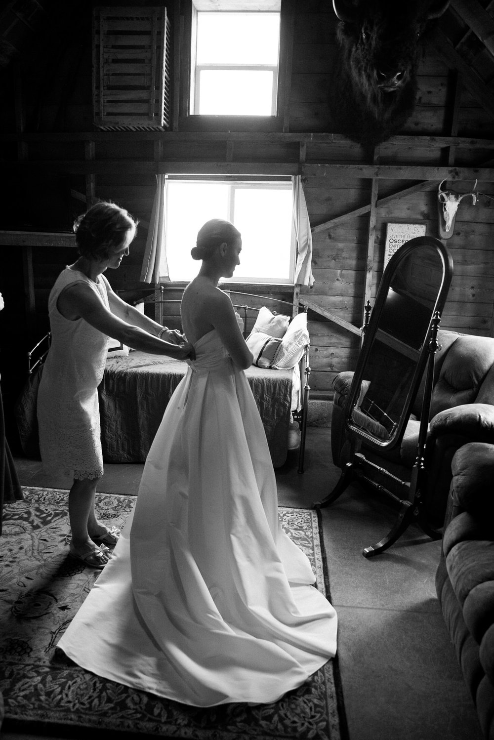 Bride, mom and maid of honor getting ready from a gorgeous Colorado wedding photographer