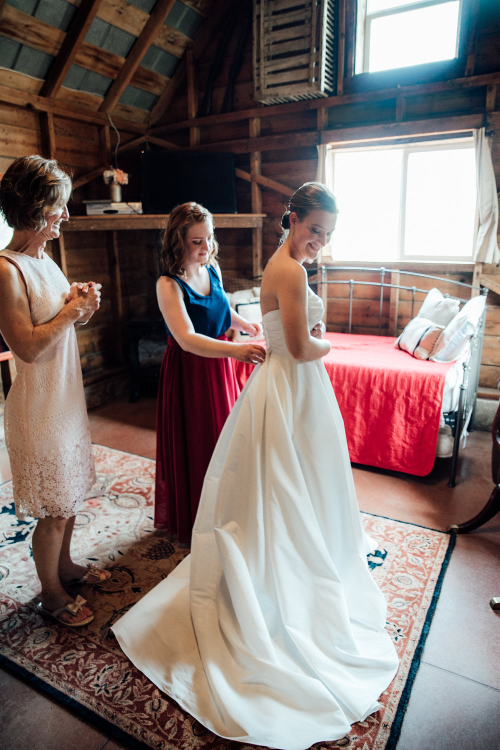 Bridemaids and getting bride one from a gorgeous Colorado wedding photographer