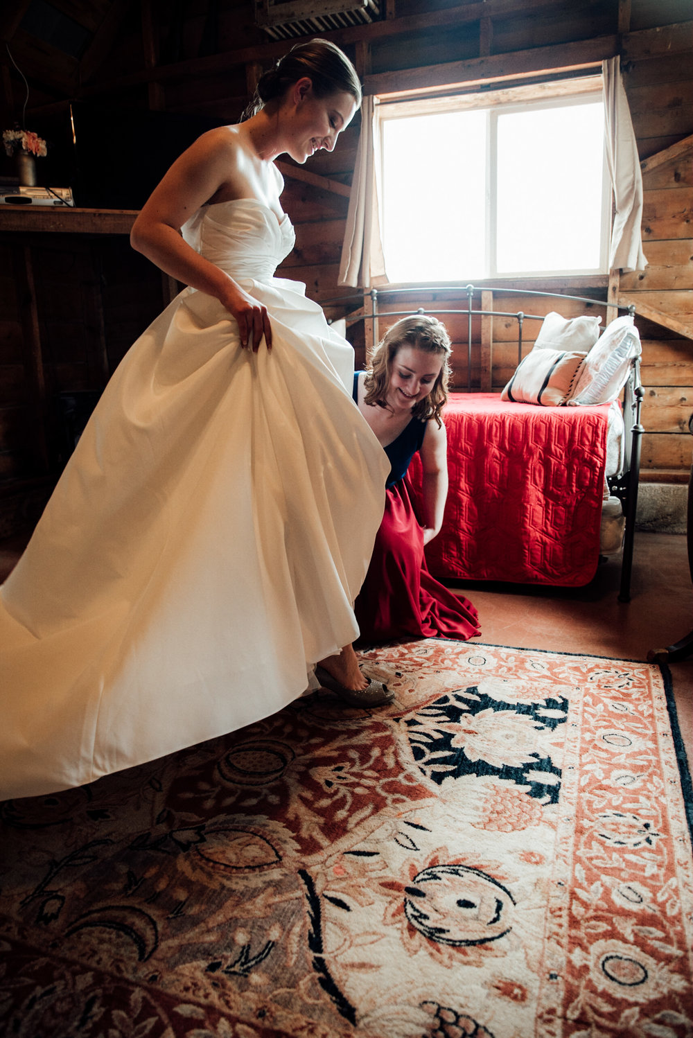 Bride putting on shoes from a gorgeous Colorado wedding photographer