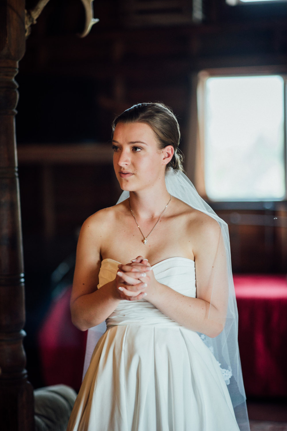 Bride waiting for father at gorgeous Colorado wedding photographer