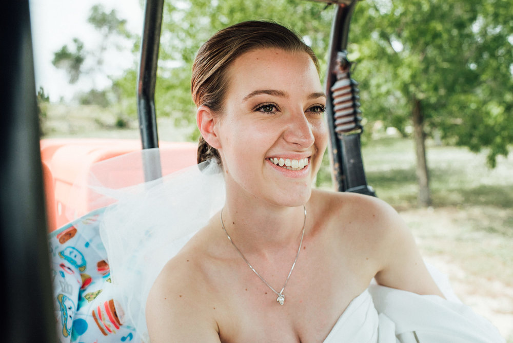 Bride on her way to see her groom at gorgeous Colorado wedding photographer