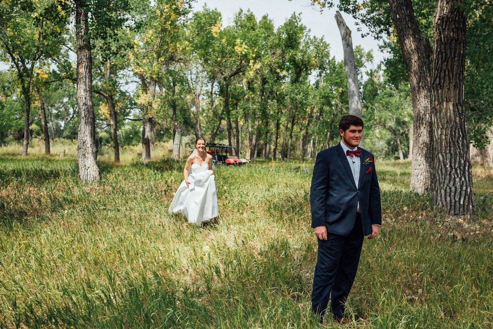 Bride approaching groom for first look at gorgeous Colorado wedding photographer