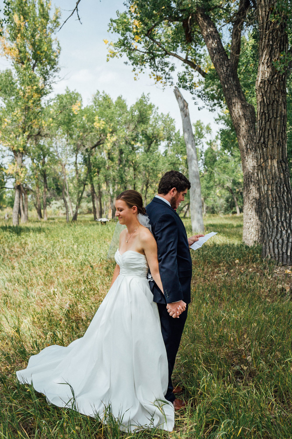 Groom and Bride holding hands before first look at beautiful Colorado wedding photographer