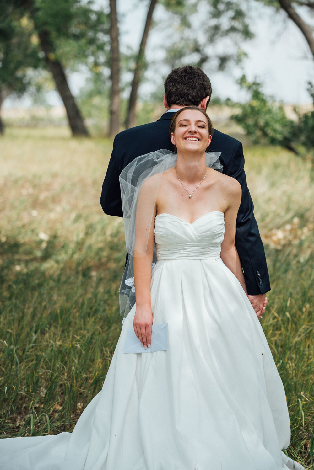 Bride laughing at Groom t beautiful Colorado wedding photographer