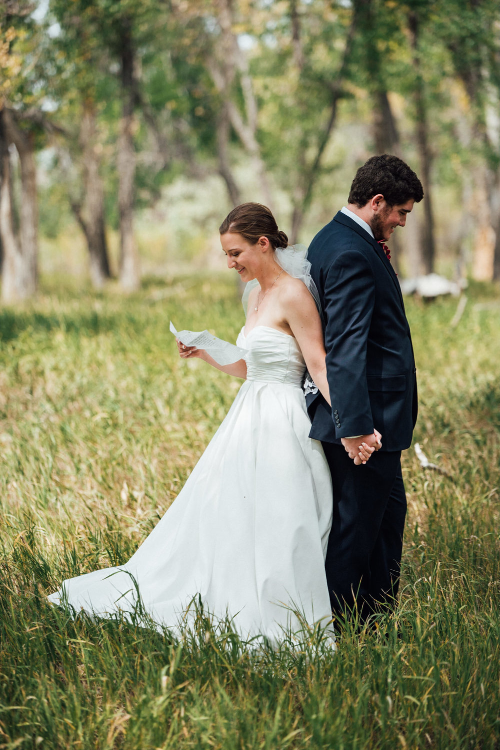 Bride reading letter to groom t beautiful Colorado wedding photographer