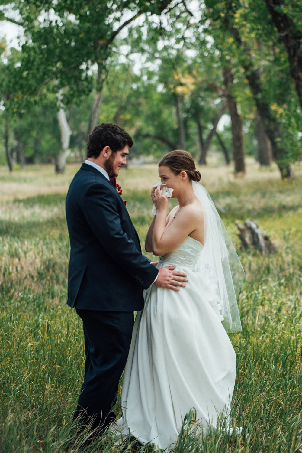 Bride and groom first look t beautiful Colorado wedding photographer