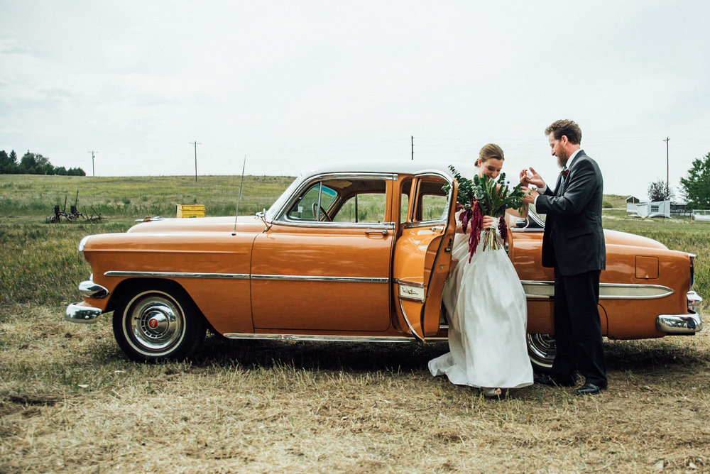 Bride getting out of the 57 Bel Air at a beautiful Colorado wedding photographer