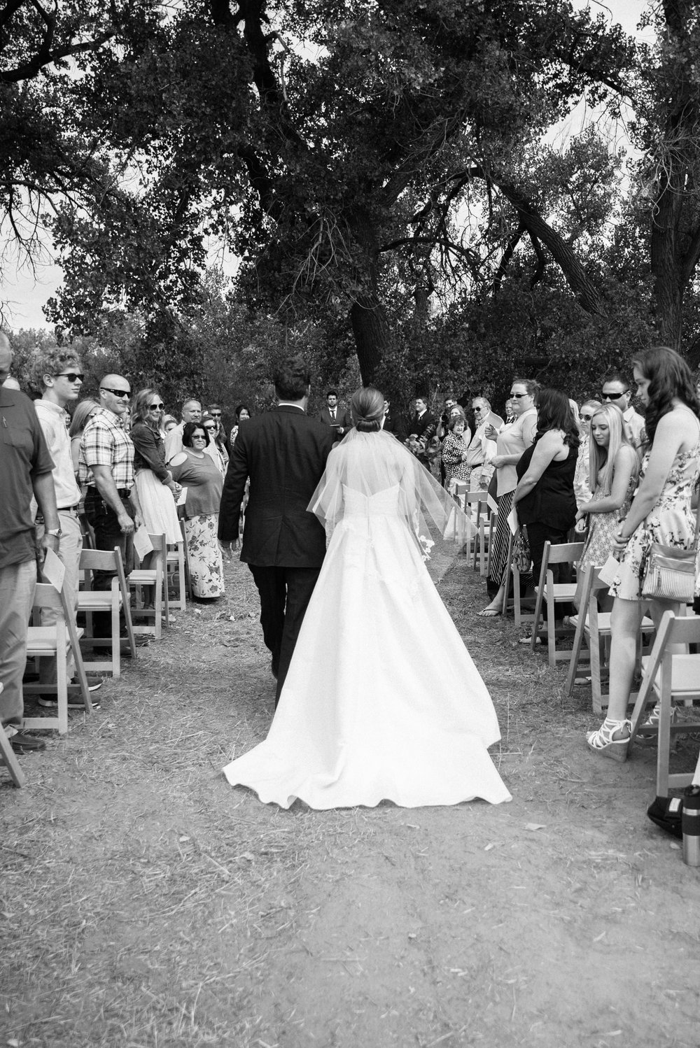 Bride and father going down the aisle at a beautiful Colorado wedding photographer