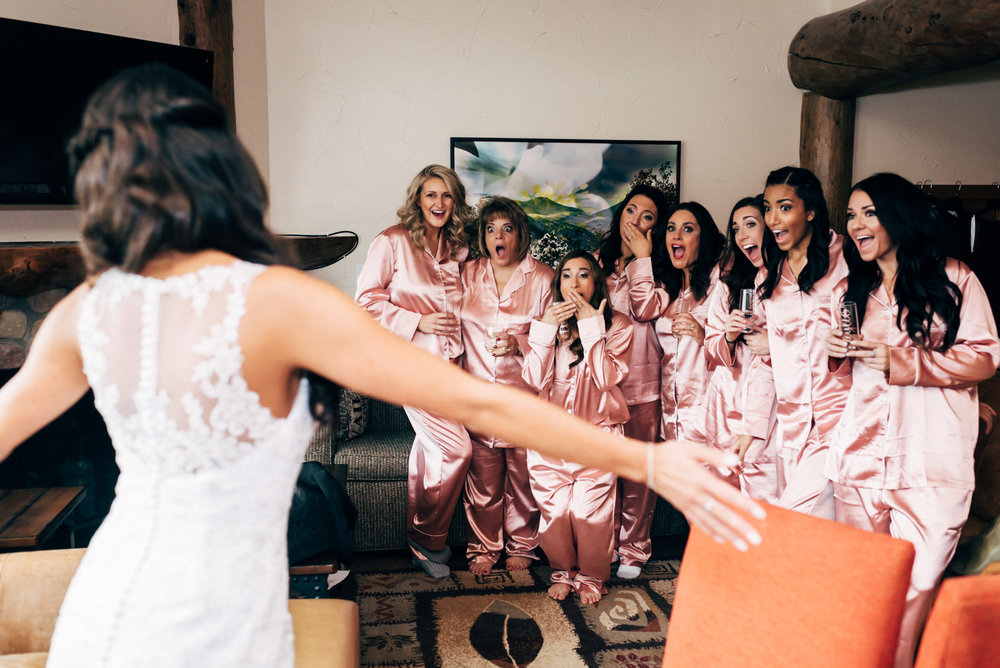 Bride looking at bridesmaid at beautiful Breckenridge, Colorado wedding. Colorado wedding photographer.