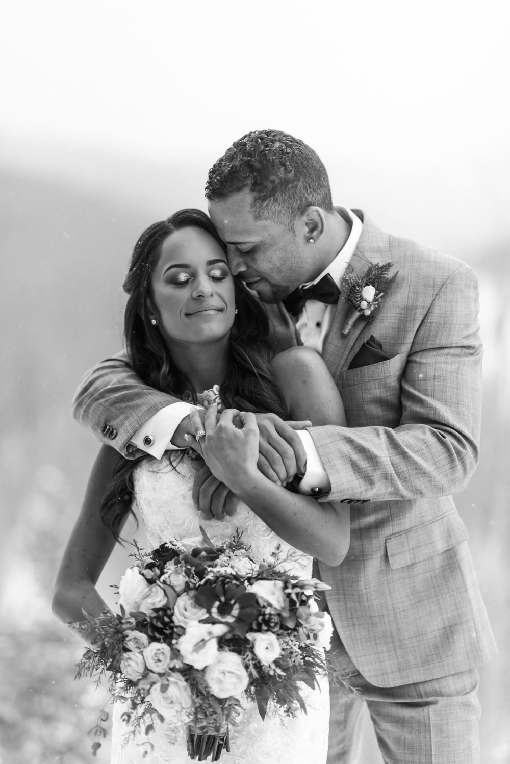 Black and white photo of bride and groom near Keystone mountain. Colorado wedding photographer.