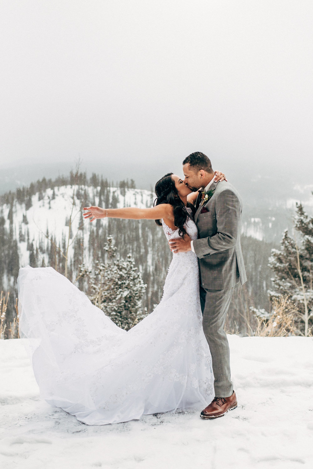 Dancing and celebrating in the snow at their Breckenridge wedding. Colorado Wedding Photographer.
