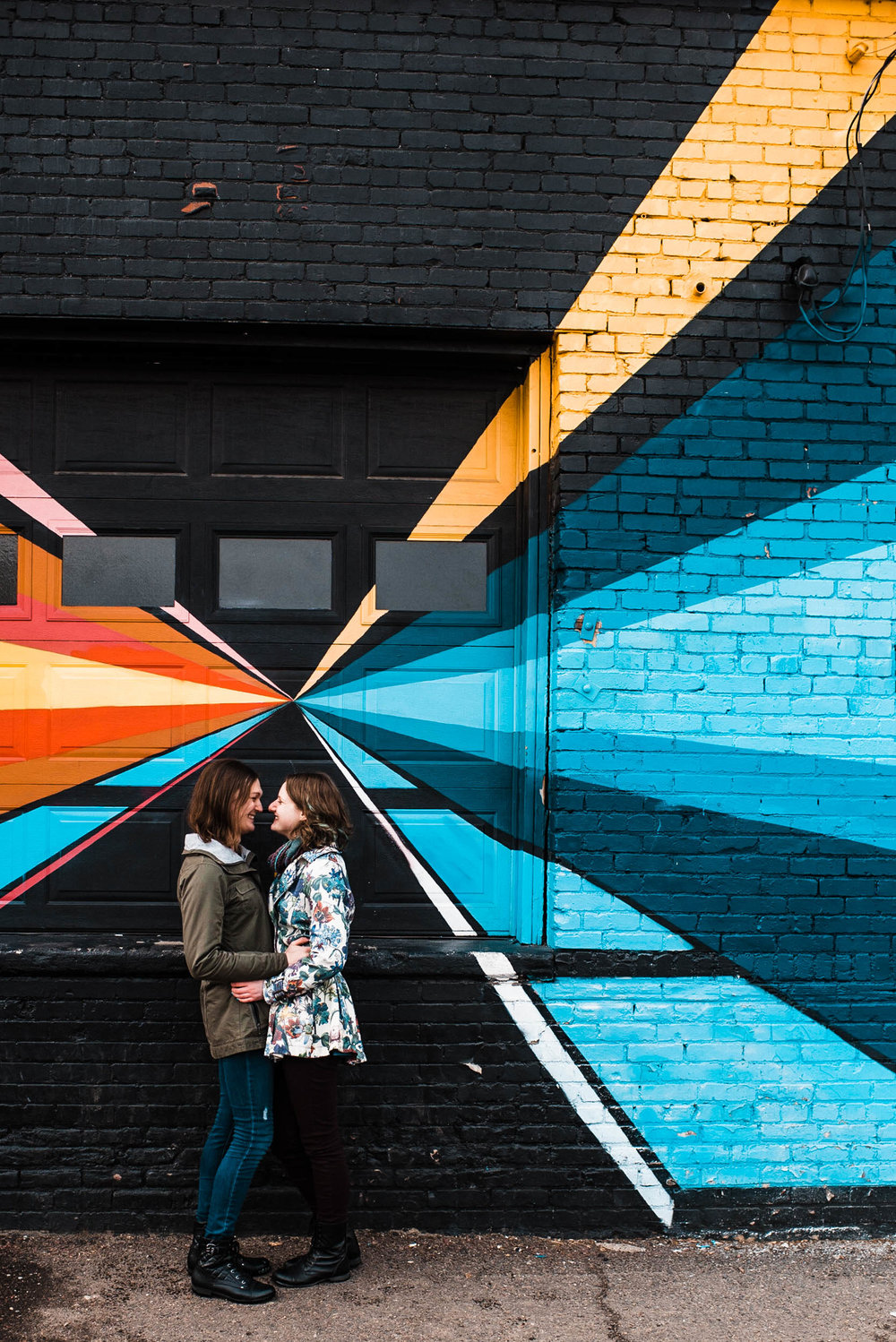 Same sex couple kissing infront of Denver Colorado RiNo art mural, RiNo Arts District, RiNo engagement session, LGBT wedding photographers, LGBT friendly wedding photographers, LGBT engagement photographers, Denver wedding photographers, Denver Engagement photographers