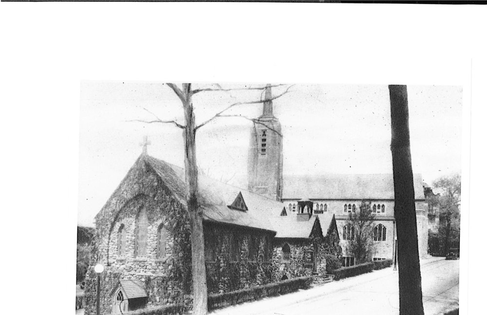 1925 - The current church was built in the late summer of 1925. Here it is pictured with the original church, which functioned as the parish house for 34 years.