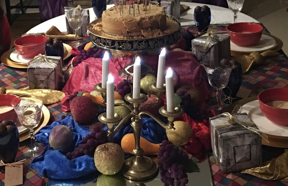 "The wedding feast from the  Princess Bride  was the theme. To make it look lush, there was lots of artificial fruit and scraps of crushed velvet, mirrors, and ""candles""."