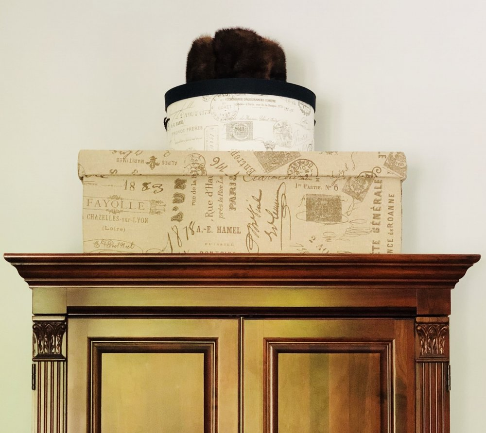 The wedding dress box is topped by a hat box containing the veil.
