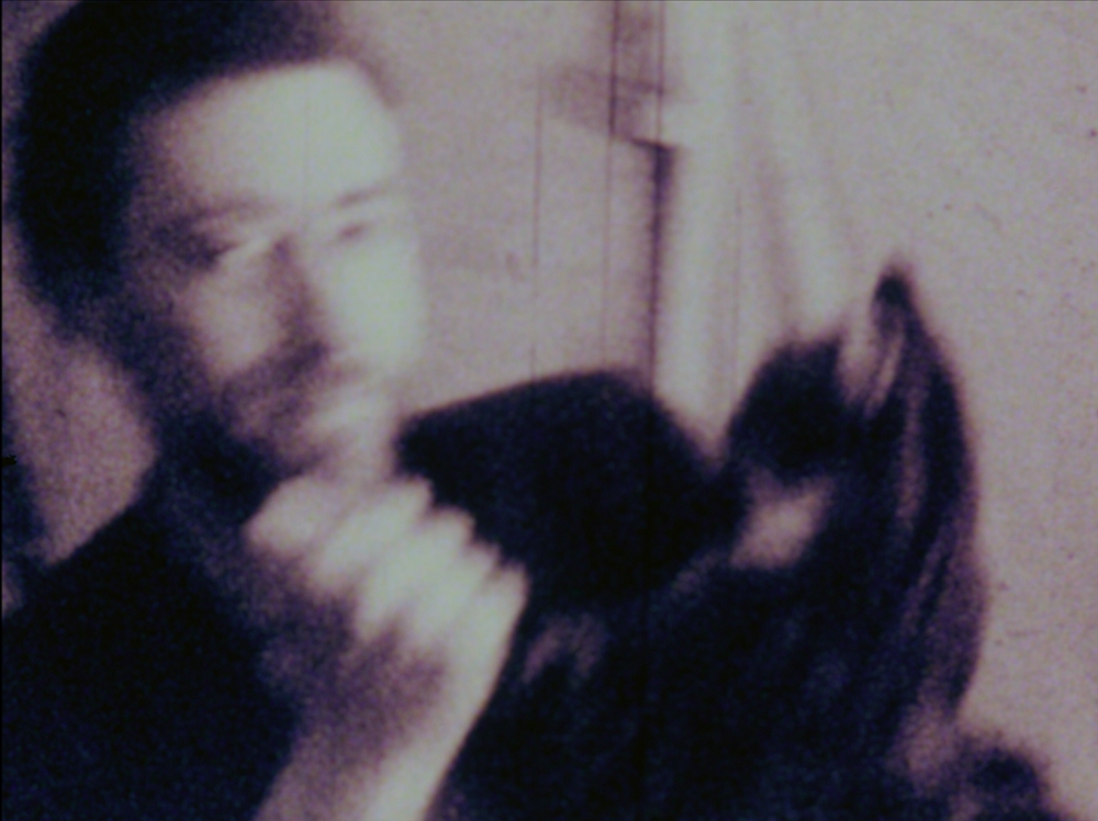 Michael Snow dances with a cat in Joyce Wieland's  Larry's Recent Behavior  (1963). Courtesy of CFMDC.