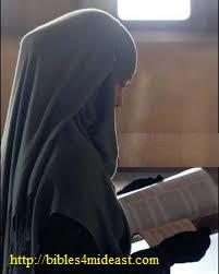 muslim woman reading Bible