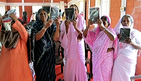 Women with bibles donated by Bibles for Mideast