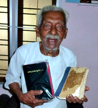 At 86, George receives a new bible to replace his well-worn old one—both which he could read without glasses!