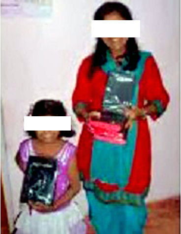Sayujya with bibles for further distribution