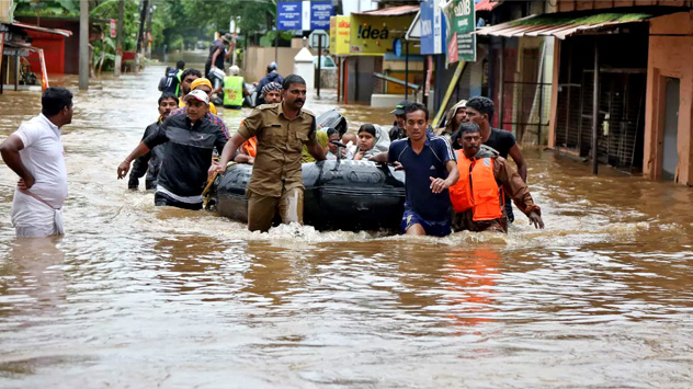 Kerala residents wading through flood waters contaminated with numerous pathogens—the prime means of transmission of the  Leptospira  bacterium that causes leptospirosis, also known as rat fever. It enters wounds on the skin from faeces and urine of infected dogs, rats and farm animals [ image courtesy Reuters ].