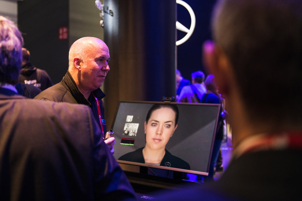 Udo Neumann, global chief information officer for Daimler Financial Services, standing next to Sarah, the 'digital human,' at 2018's Mobile World Congress in Barcelona. Photo: Daimler AG