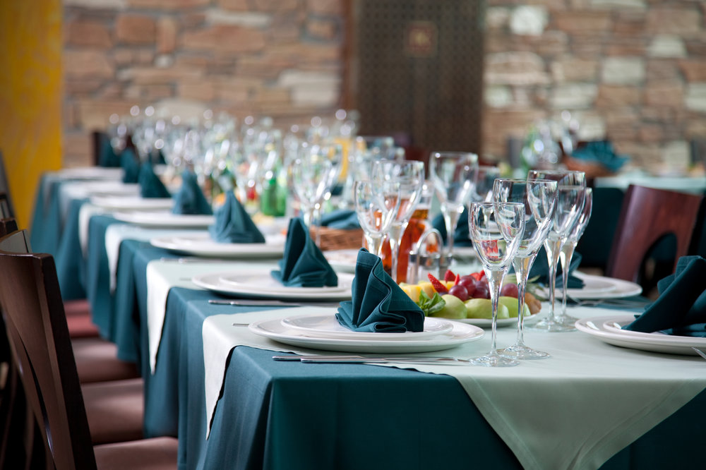 Table-set-for-an-event-party-or-wedding-reception-91522033_3869x2579 (1).jpeg