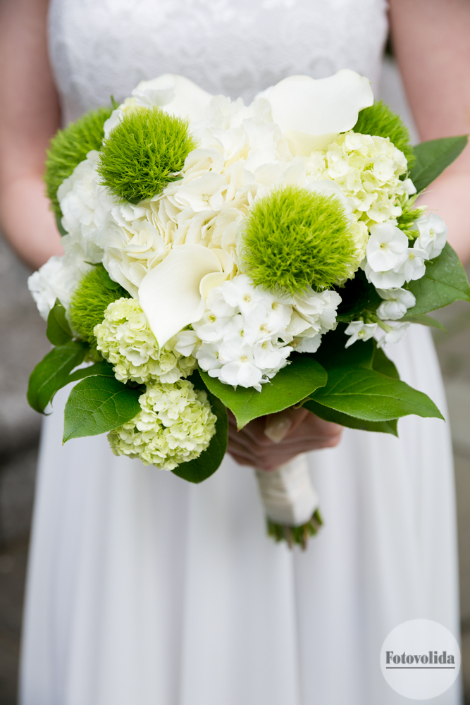 Bridal bouquet with fresh green and white flowers