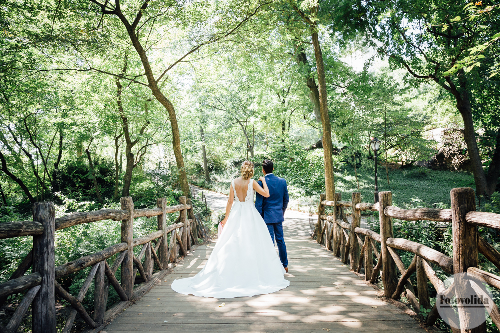 Wedding photo on wooden bridge in Central park