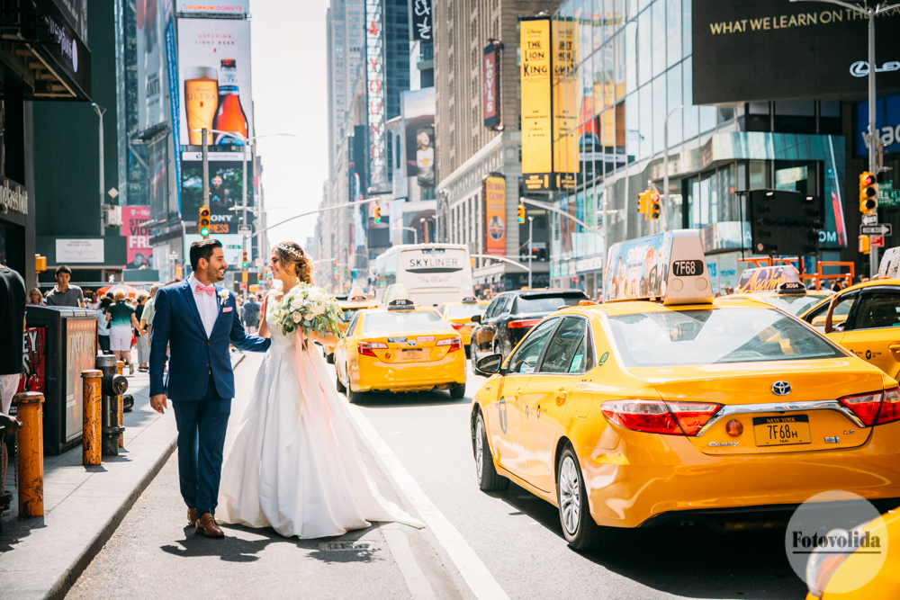 Wedding photos on the street in Times Square with yellow taxis