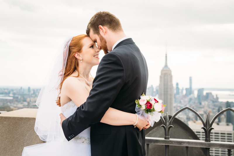 Bride and groom with Empire State building