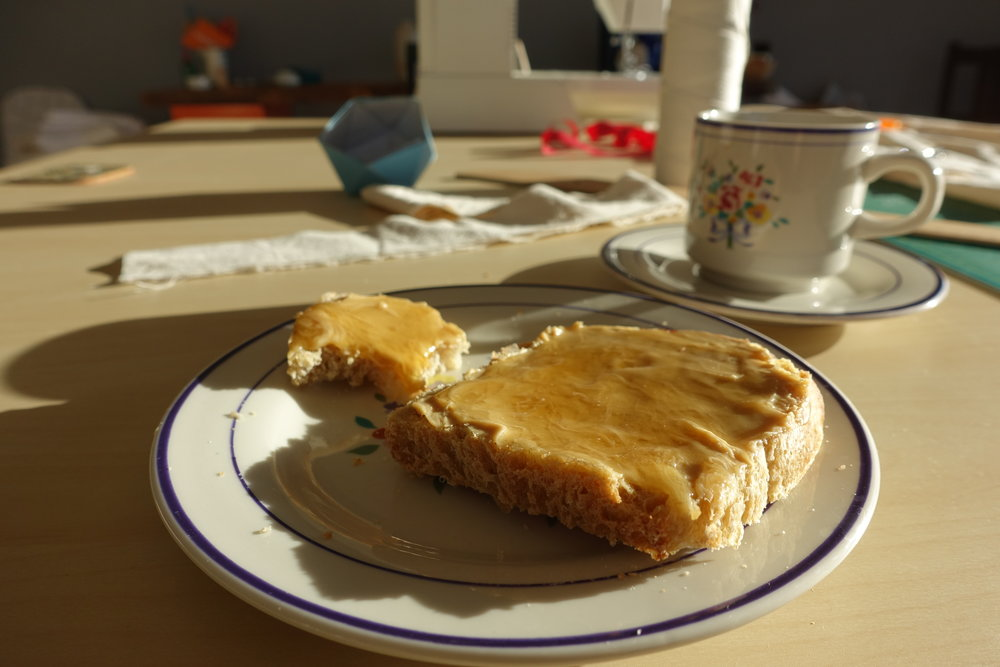 An energy bomb for the downfall of afternoon time: peanut butter and honey on sourdough bread accompanied by black coffee.