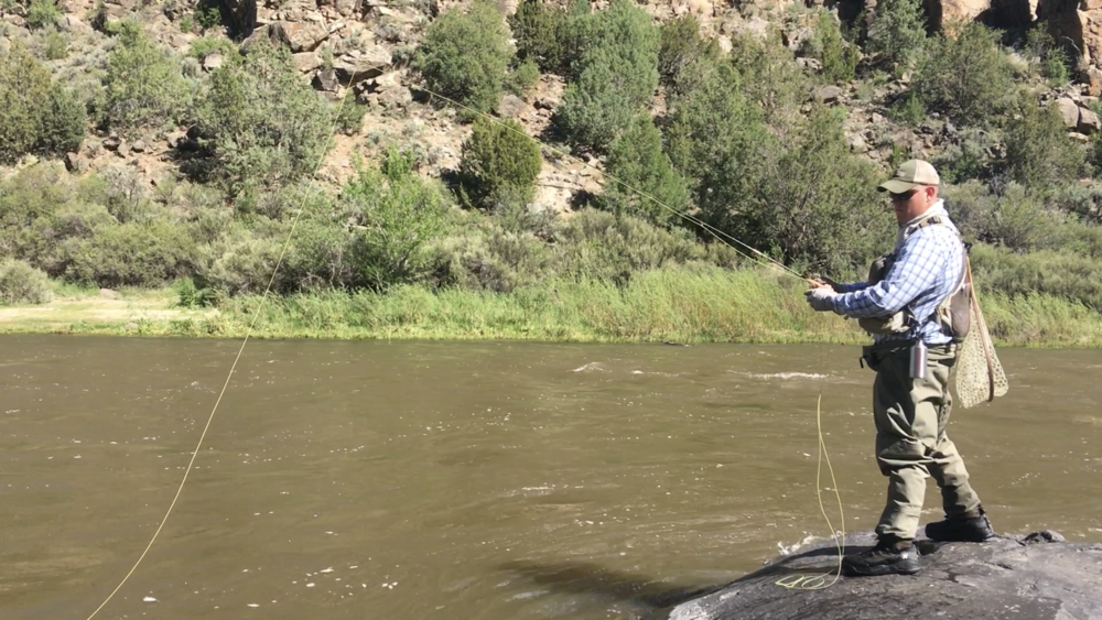 Andrew Black fishing on the Wild and Scenic River area of the Rio Grande Del Norte National Monument, protected using funding from LWCF.