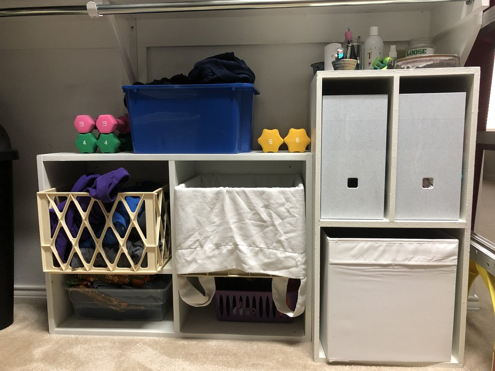 My post-dresser storage. Dresser drawers are cumbersome; these open bins mean I can wrist-flick items of clothing into their places.