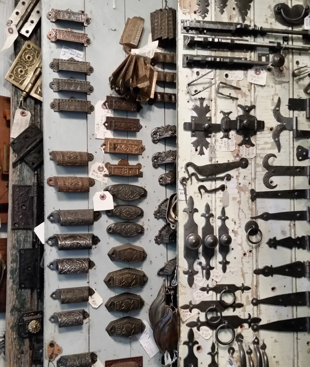 Some of the antique drawer pulls, latches, knobs and hinges.