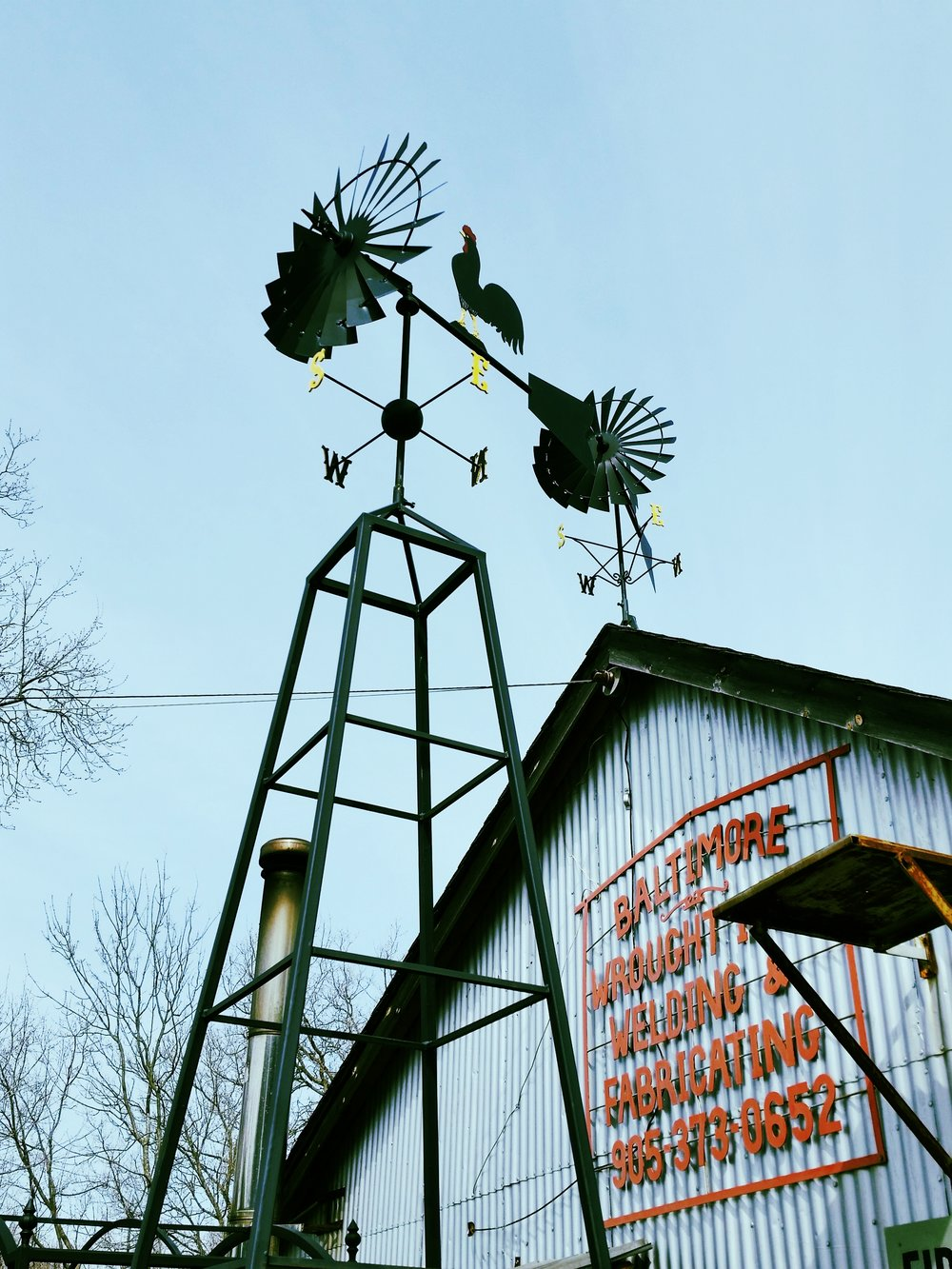 A Rooster wrought iron weathervane.