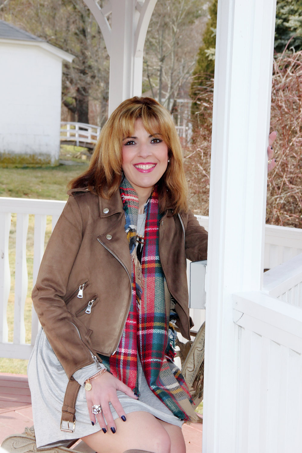 The dress is called forever flawless and can be found here:  https://www.sassygracecharm.com/collections/fan-favorites/products/forever-flawless-dress The scarf is called perfect plaid blanket scarf and can be found here:  https://sassy-grace-charm-boutique.myshopify.com/products/the-perfect-plaid-blanket-scarf?utm_medium=precommend&utm_campaign=offer&utm_source=popular&app=precommend