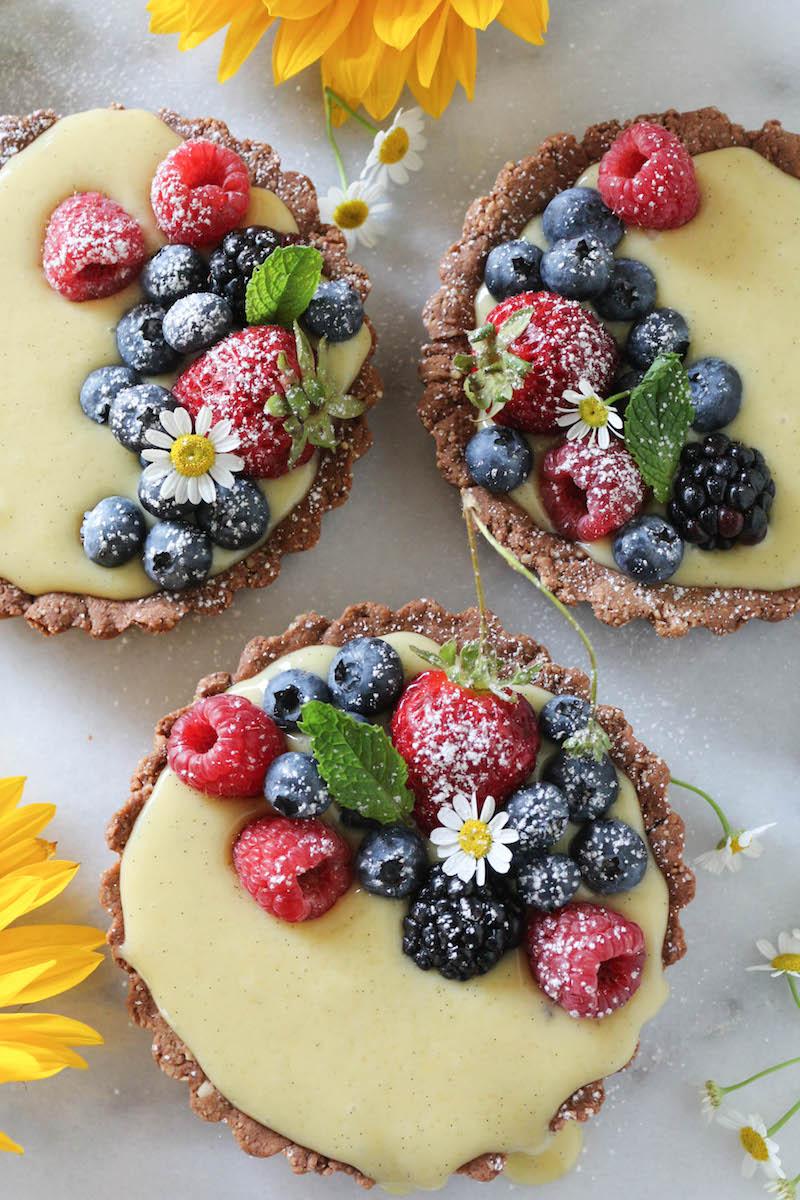 http://paleomg.com/mixed-berry-vanilla-bean-cream-tarts/