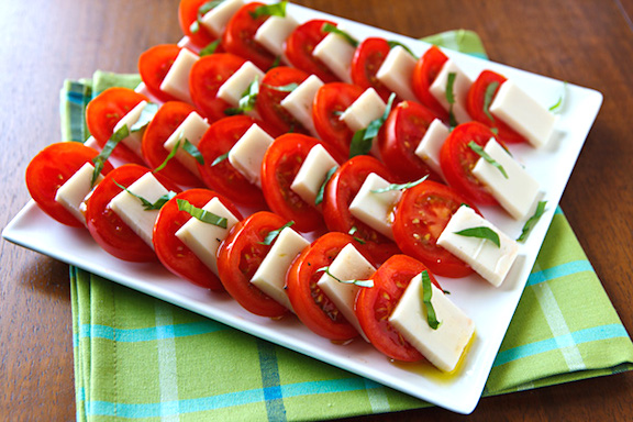 Tomatoes with Basil and Mozzarella   http://www.vegkitchen.com/recipes/vegan-caprese-salad/