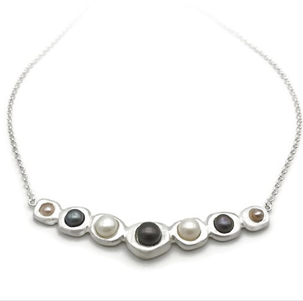 This is from the Pearl of Wisdom Archives. It is called the Stepping Stone Fine Silver Pearl Necklace and found  here .