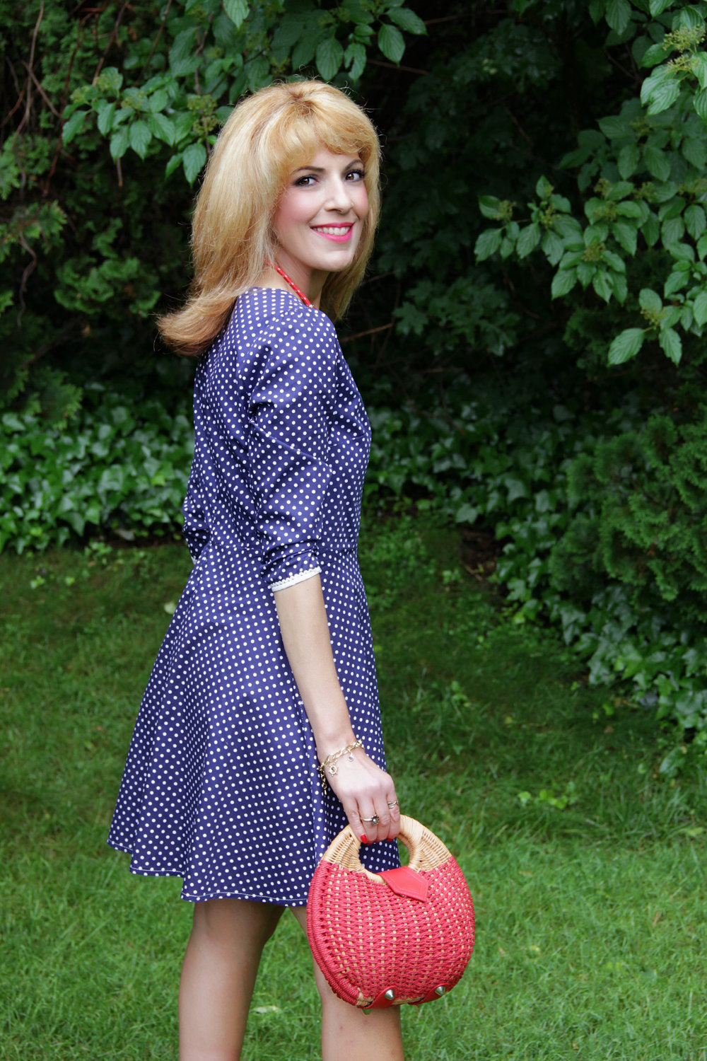 Find this crisp, adorable polka dot  dress   here . It is available in other colors, fits true to size and I've washed it and worn it a few times without any need to press. The fabric is a cotton microfiber with delicate lace detail and it is only 8.99!