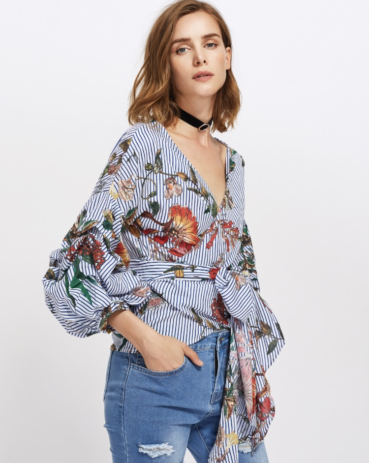 This is the  Gathered   Sleeve   MultiColored   Wrap   Top  and I love how it looks with the distressed jeans. Find the top and so many great denim pieces  here.