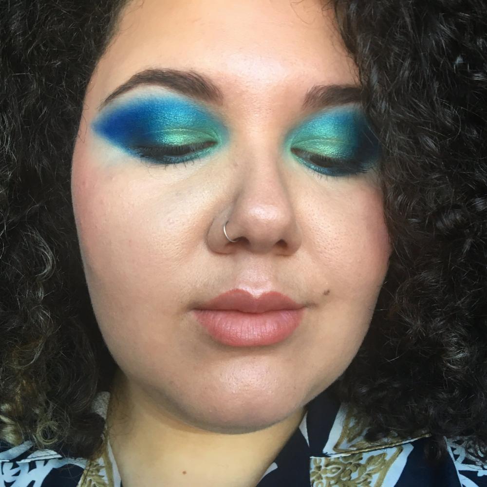 Headblush makeup artist Sofaya Hussein wearing bright blue and green eyeshadow makeup