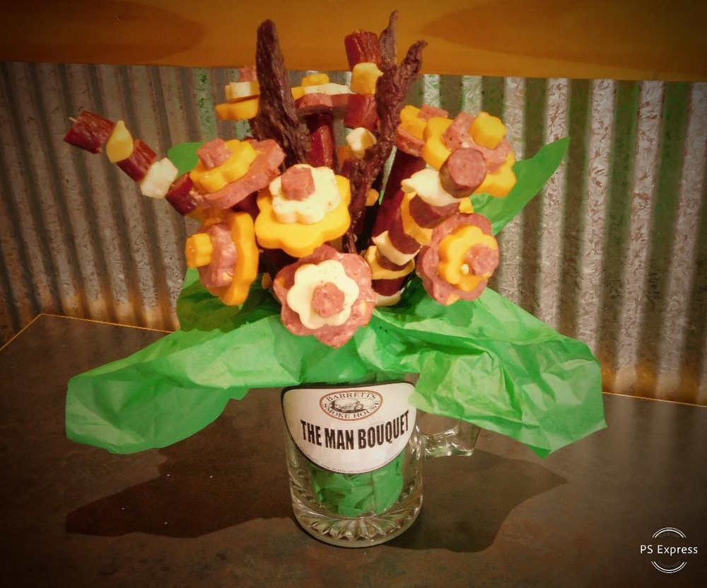 The Man Bouquet - Flower Bouquet made of Smoked Summer Sausage, Beef Sticks, Beef Jerky, Smoked Cheese & Cheese Curds all in a Beer Mug.$49.99 Only Available on February 14th 2019Pre Orders Only, Must Be Ordered by February 12th 2019Delivery Available $15.00(Certain Mile Radius & Delivery Time Available Call for Information & Details)