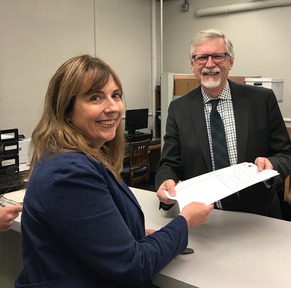 Brenda Noel picks up nomination papers at Newton City Hall from City Clerk David Olson.