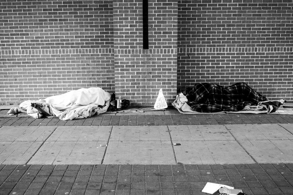 two homless people sleeping.jpg