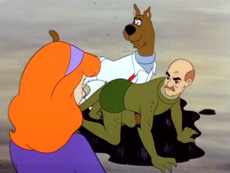 "Daphne: ""Well Scooby, it looks like you've oiled and foiled the alarmingly attractive monster man!"""