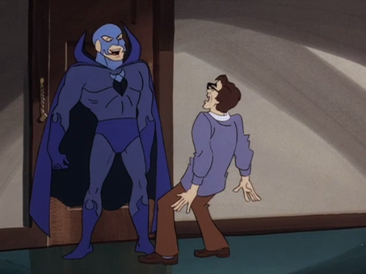 "Blue Scarab: ""It is I, the Blue Scarab, come to life to haunt you, my creator! Cower before the towering pectorals you yourself conceived!""  Jerry Sloan: ""I REALLY DID MAKE YOU SCARY BUFF."""