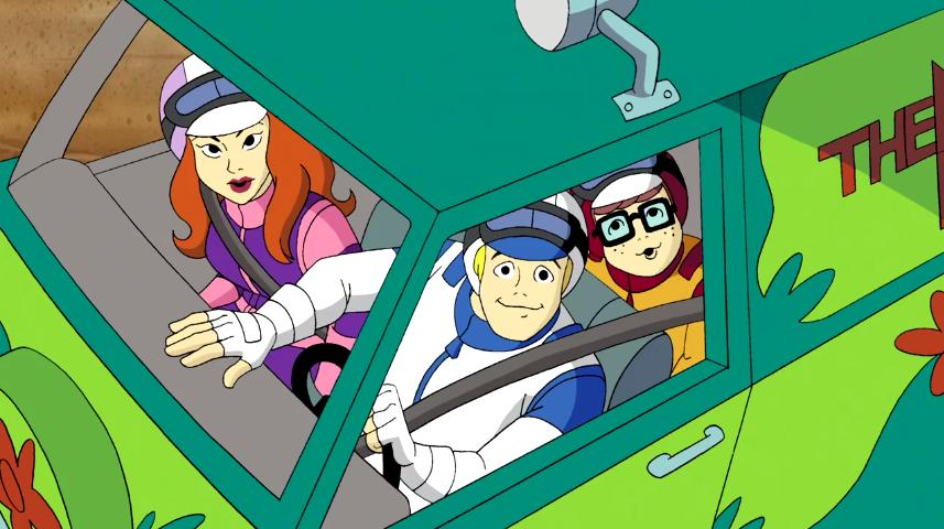 The gang drive past a Magic Eye billboard.