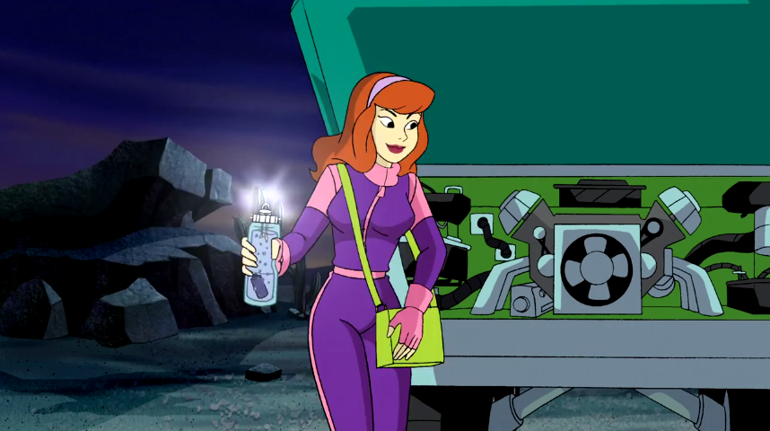 Daphne prepares to chuck a MacGuyver'd hydroelectric battery under the hood of the Mystery Machine, solving the problem of a punctured fuel tank.